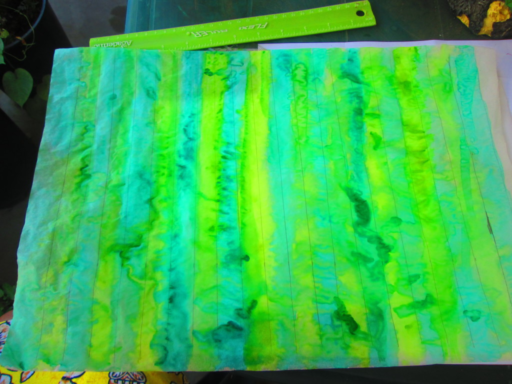I used water paint to create alternating light and dark shades of green stripes on the transparent paer.  This will give the look of the different shades illuminated from sun drench palm fronds.