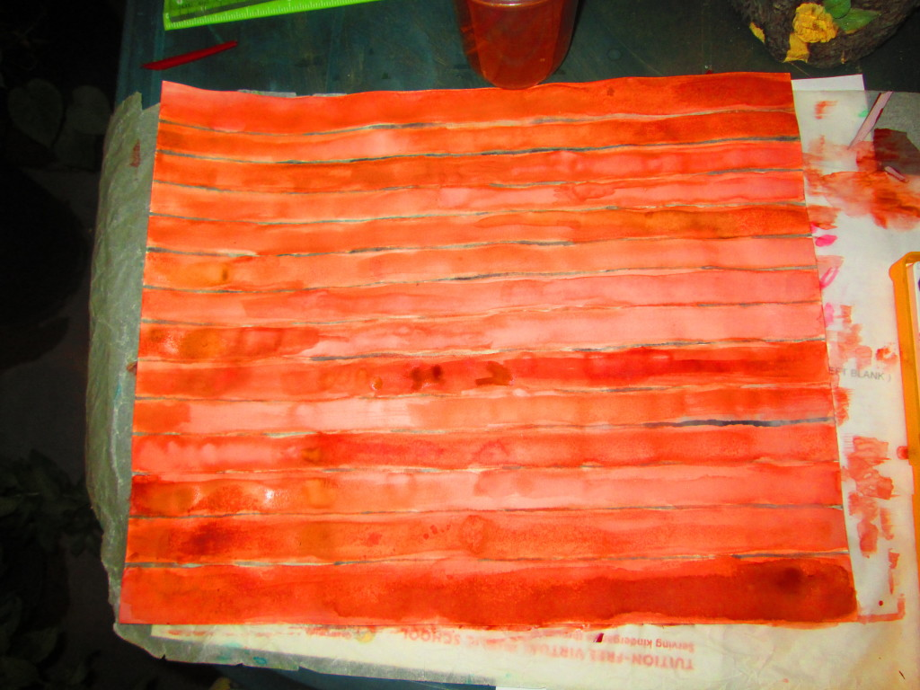 I took a sheet of water color paper and painted it with black lines, and then painted over that with brown paint.  These was meant to mimic the ridges found on palm trees.